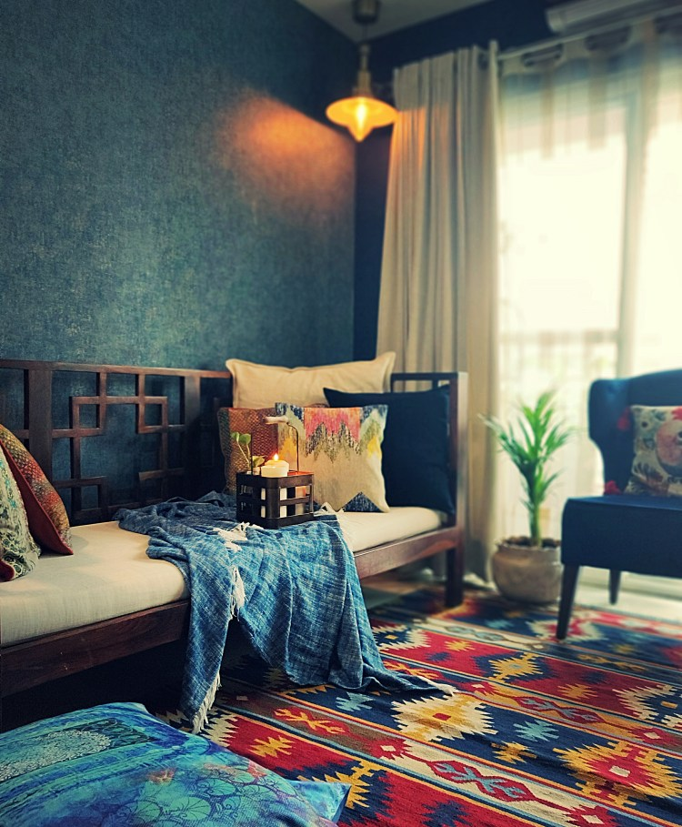 Home style Tour with Rajni in Hyderabad: the collection of colorful rug, seater sofa, cushion covers, plants and metal bottle holder makes the living area gorgeous