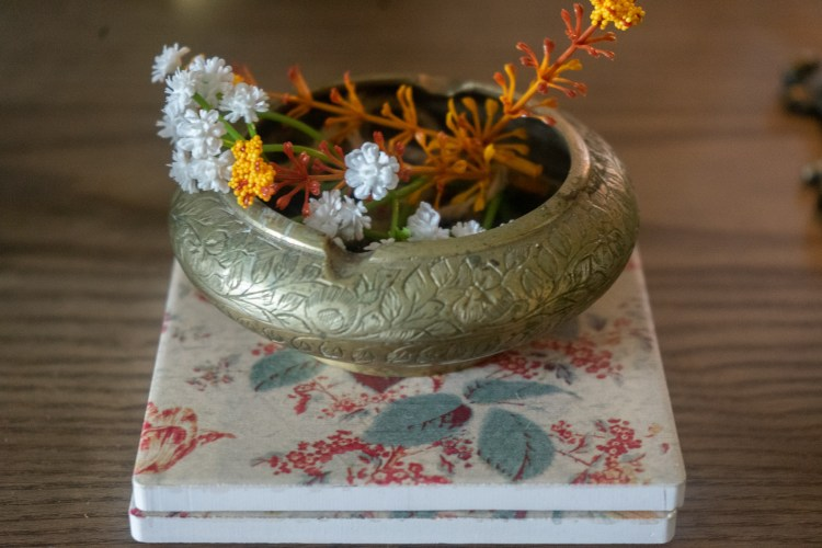 Affinity for antiques home tour of Rushika & Dipkal's - the brass bowl is filled with flower