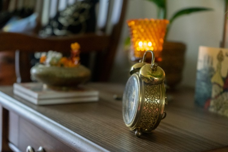 Affinity for antiques home tour of Rushika & Dipkal's - the antique clock at the corner of the room