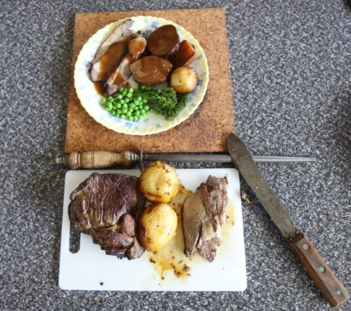 Seasoned roast lamb with veggies