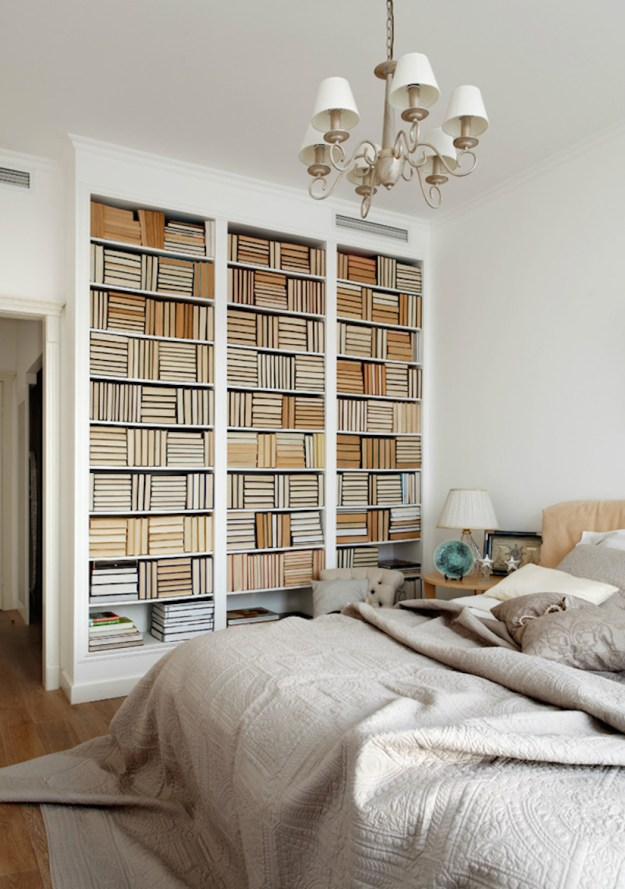 Backwards bookself wall in a master bedroom