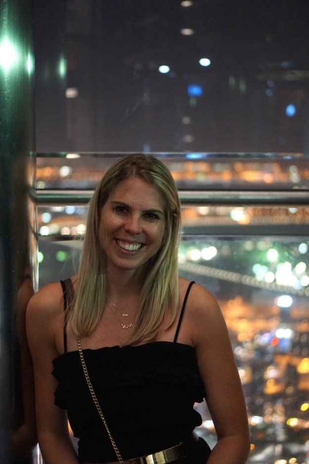 Sarah Lagen standing at the top of the Burj Khalifa