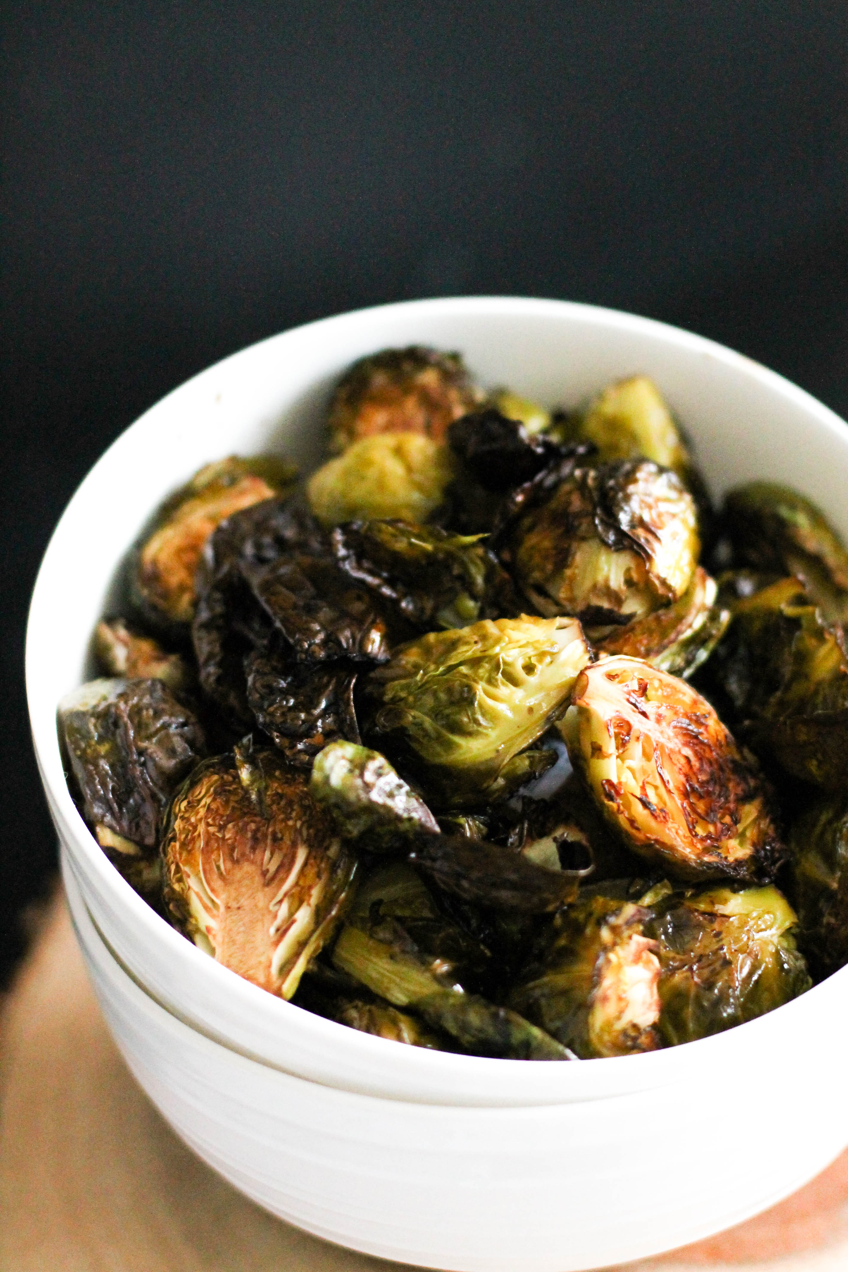 These crispy balsamic roasted brussels sprouts are the perfect side dish, and add tons of flavor to a meal. They're crispy, gluten free, and ready in under an hour.
