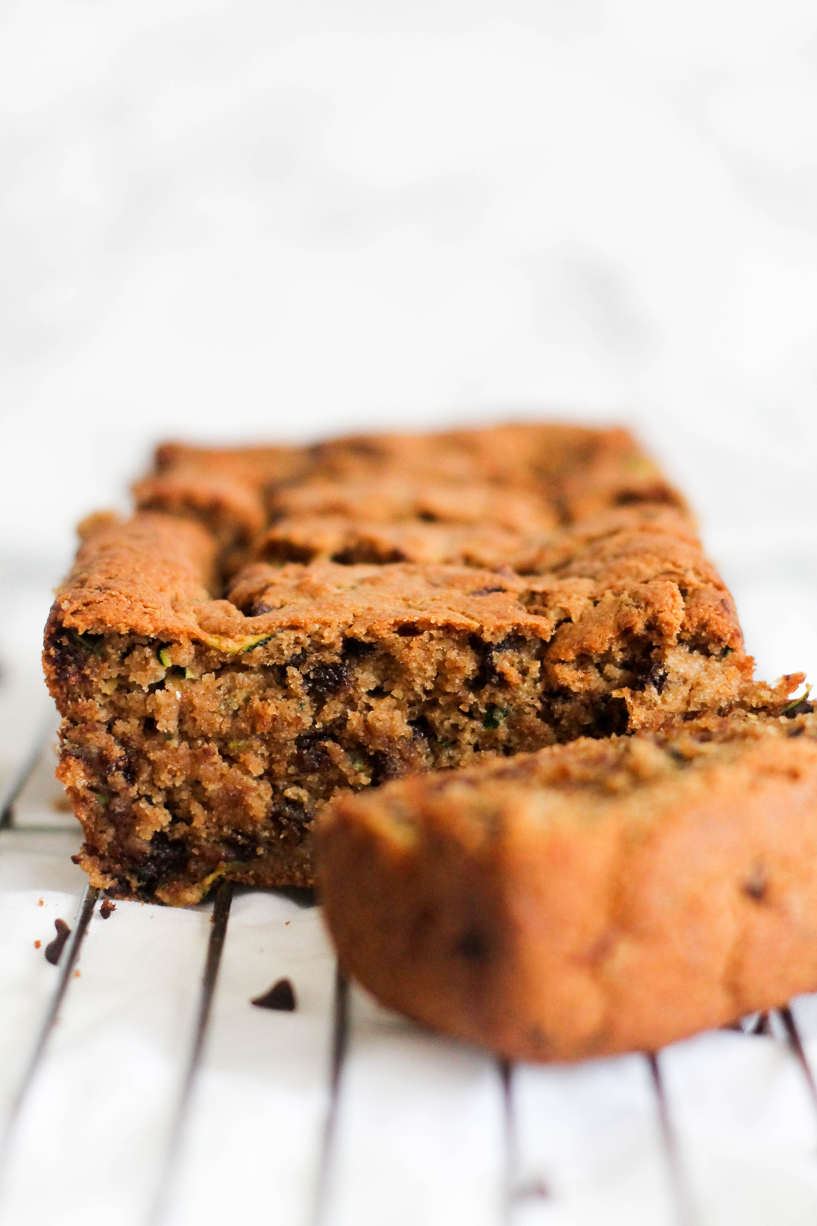 This chocolate chip zucchini bread is vegan, gluten free, refined sugar free, and absolutely delicious. It's filled with chocolate, flavor, and makes for the perfect dessert or snack!