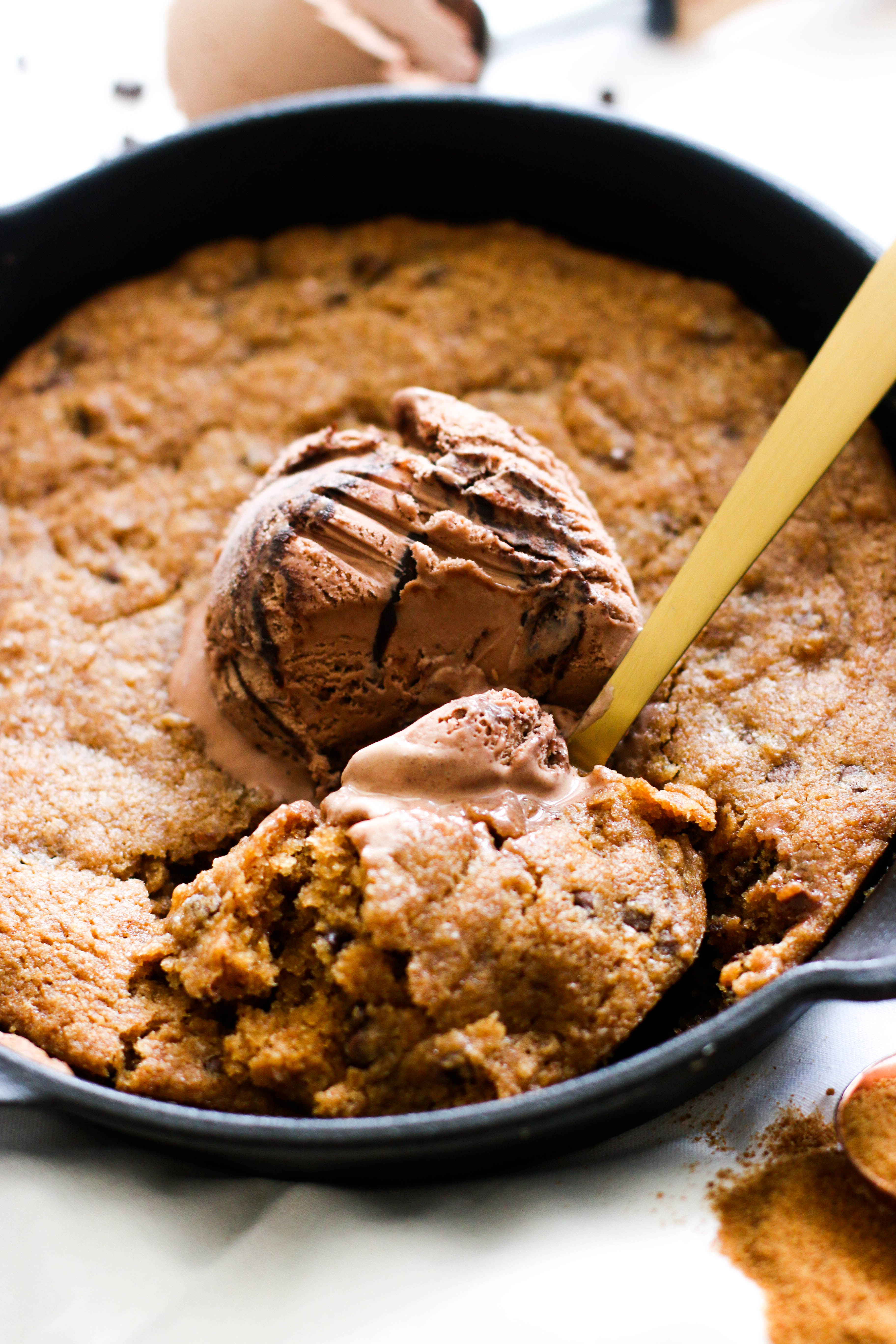 This vegan salted chocolate chip cookie skillet is filled with flavor, chocolate, and makes for the perfect dessert! It's made with minimal ingredients and comes together in under an hour.