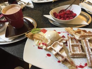 Waffles with vanilla ice cream and hot raspberries. Delicious!