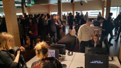 The crowd builds at the opening of the exhibition