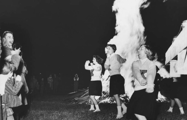 Cheerleaders in front of the homecoming bonfire in 1959 (via Kalamazoo College CACHE)