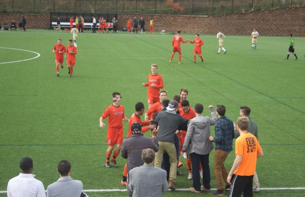 The men's soccer team celebrates their win over Alma in their previous meeting with the student crowd (Rachel Carson / The Index)