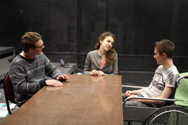 """Sean Bogue '18, Emma Franzel '17, and Kyle Lampar '17 in a scene from """"Immobile"""" by Brittany Worthington '13. (Emily Salswedel '16)"""