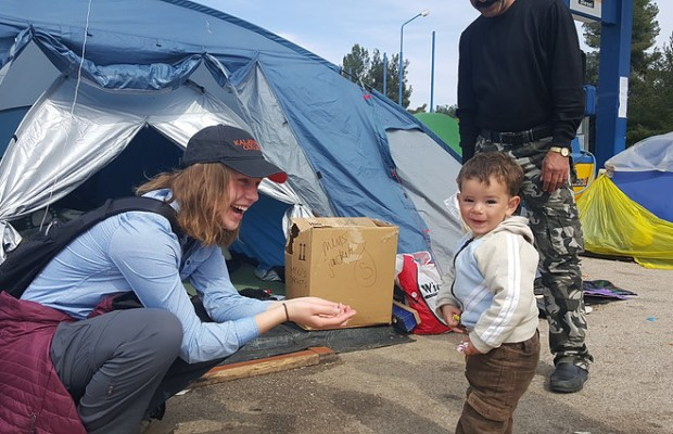 Founder Emily Worline '17 with child [Refugee Outreach Kalamazoo / The Index].