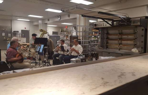The Brass Rail quintet jam with ease in the back of the bakery near the kitchen [Uyen Pham / The Index].