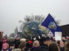 Marchers carry giant blow-up earth through the crowd [Ayla Hull / The Index].