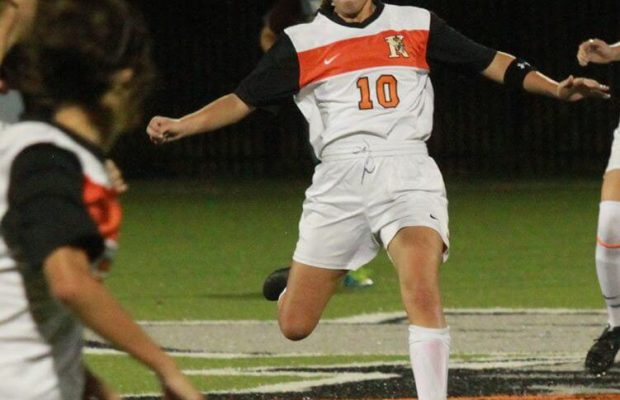 Suzanne Miller K'17 playing soccer.