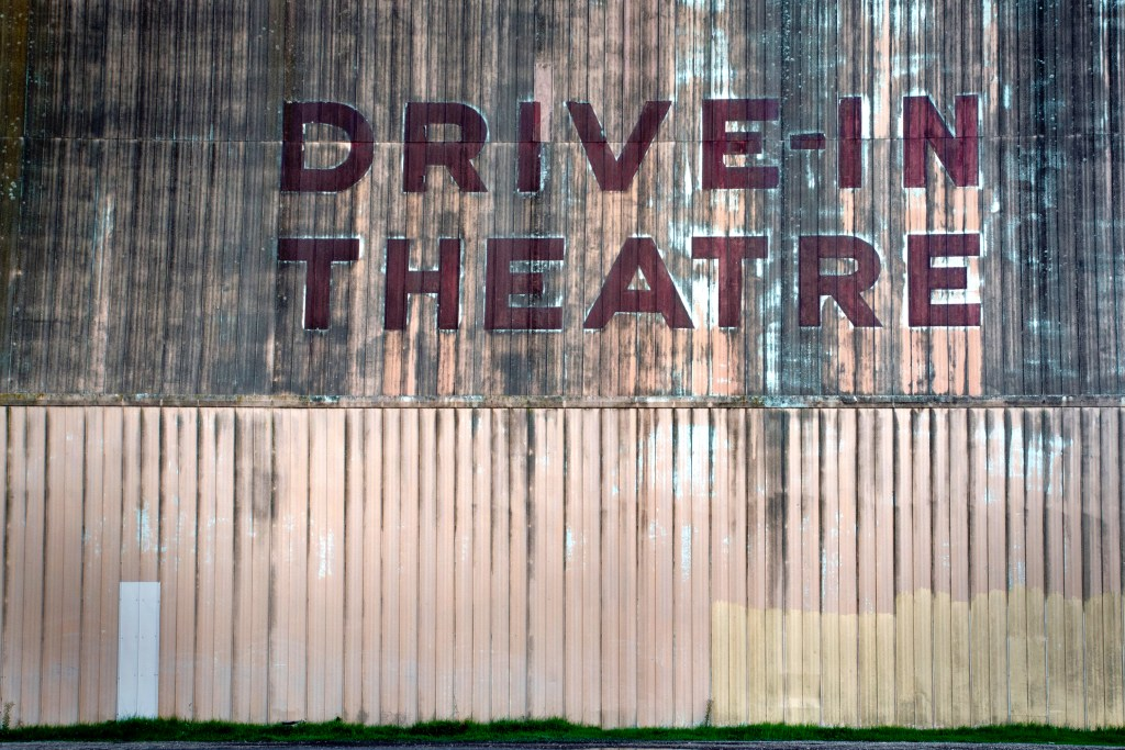 A drive-in theatre sign. AVOIDING EXPENSIVE TRAVELS |  The Lady-like Leopard by Melina Morry