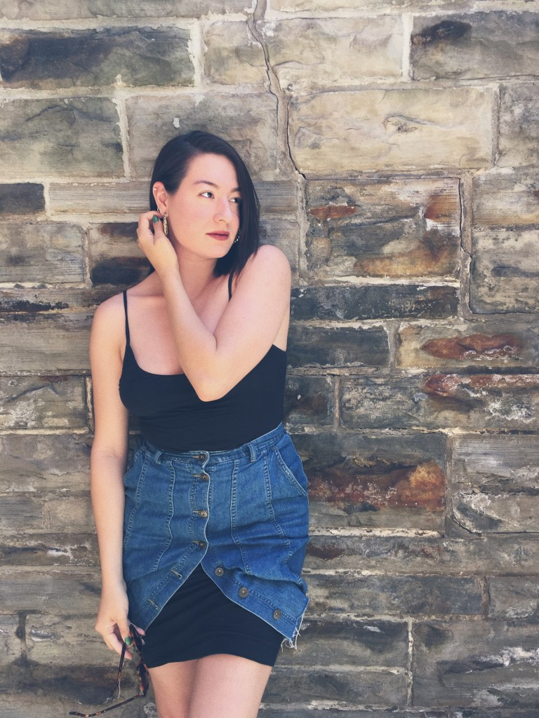 Fashion writer Melina Morry of The Lady-like Leopard in a denim skirt, black tank, leopard sunglasses and gold hoops | LADYLIKELEOPARD 2017