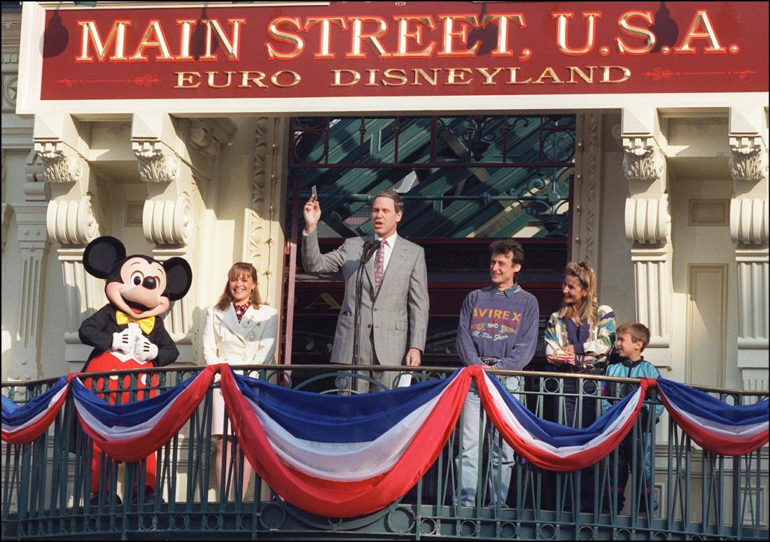 Disney CEO Michael Eisner standing on a podium giving a speech on Euro Disney opening day, 1992.