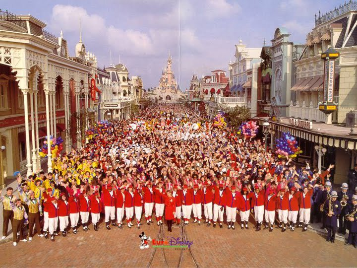 Crowd of employees gathered in Main Street USA in Euro Disney, 1992.