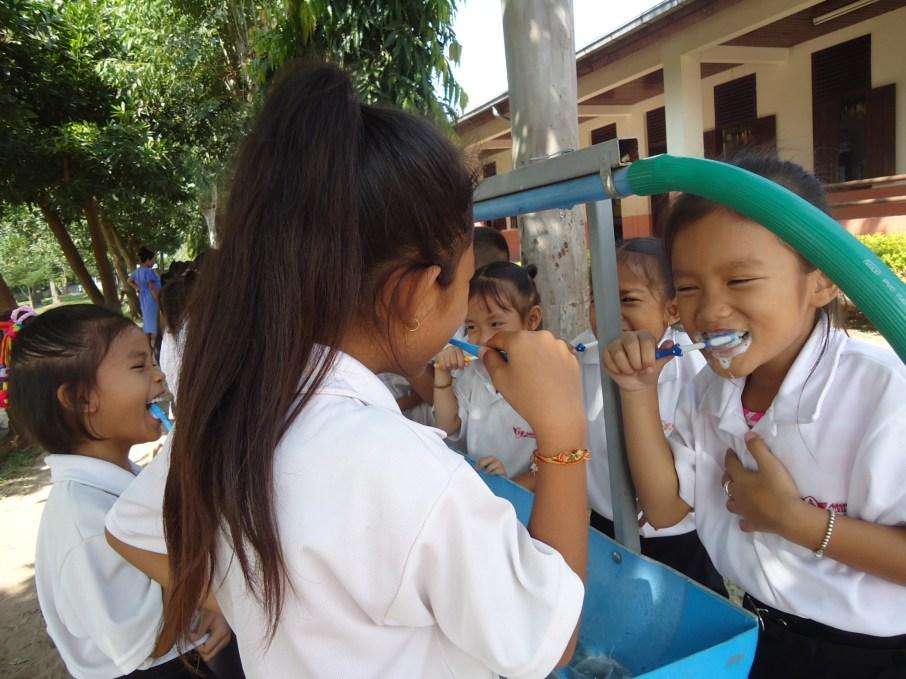 The children brush their teeth
