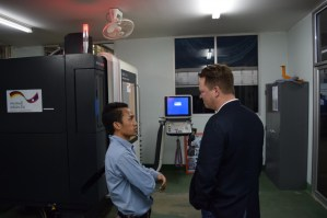Phonesavanh Chachueyang, CNC specialist, speaks with Lars Engel