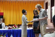 """Mittaphone """"Mit"""" Sichampa (English teacher at Sikeud primary school) receives her certificate from Johannes Zeck & Prof. Marti (""""John & Izzy"""")"""