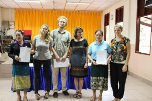 Lathsamy Chanthavongsa & Bounpheng Singhalath (teachers at Phang Heng primary school) receive their certificates from their tandem teachers Silja Schäfer & Sara Stöhrer