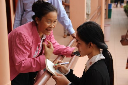 Linda with a pupil in the secondary school