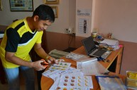 Bounleud Sengsavangvong works with his favourite device - the laminator
