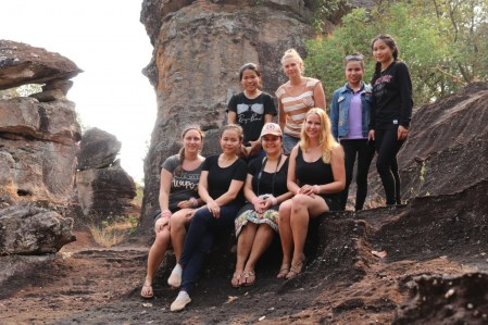 At the top of the mountain (from left to right and front to back: Rebecca, Toukham, Laura, Veronika, Saysamone, Silja, Donekeo & Khamsee)