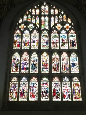 Stained glass windows pointing up in an arch