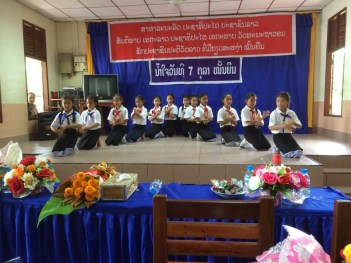 Fifth graders performed a traditional Lao dance on stage