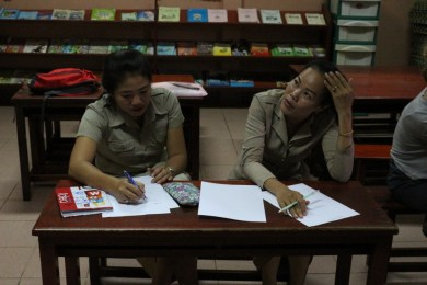 "Ms Mittaphone ""Mit"" Sichampa and Ms Phovang ""Noy"" Inthavong work on a skeleton"