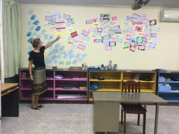 Sandra presents the new wall decoration to Prof. Martin