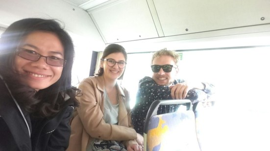 Ketsana Siphonephath, Johanna Landvogt, and Johannes Zeck in a public bus on their way to the castle of Wuerzburg