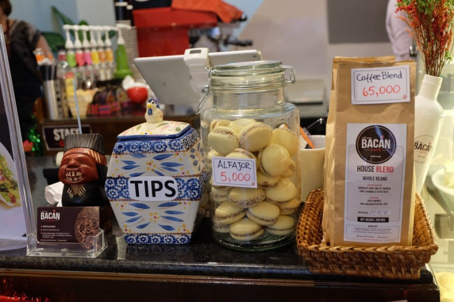 "Display at the cashier's desk with the traditional Sout American Cookies ""Alfajores"" and coffee beans from the Bolaven Plateau"