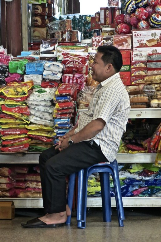 Shop owner at the Northern Bus Station, Vientiane