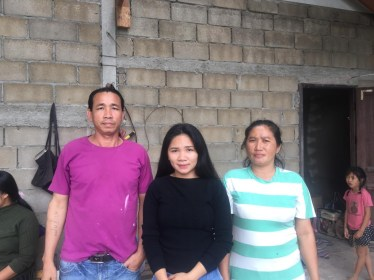 Ms Toukta Sulinthavong with her parents, who live in Phan Heng Village.
