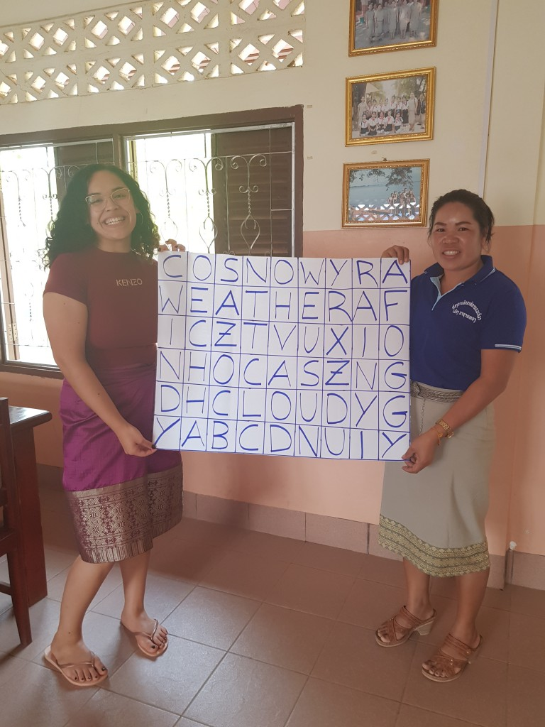 """Ms Bounpheng and """"teacher Elisabeth"""" show their crossword puzzle for the next lesson."""