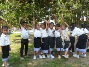 ... and the pre-schoolers proudly present their toothbrushes.