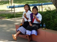 Two pupils rest in the shade during the break.