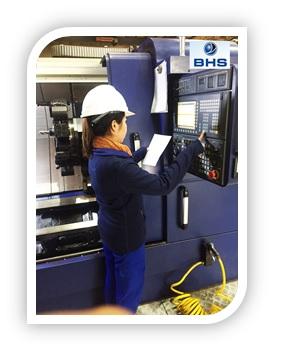 Miss Toukta operates a CNC machine...