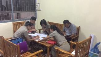 ... and their hard-working teachers practising their English skills.