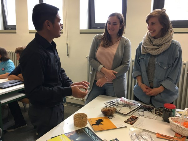 Mr Thaithanawanh Keokaisone (SKU) explains Lao traditions to Yvonne Jaqueline Dyck and Lena Hopf...