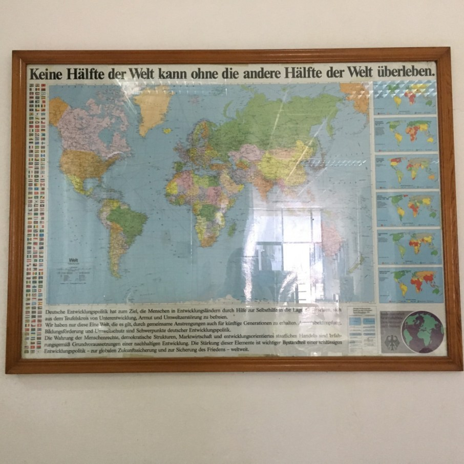 """Old map with new meaning (in front of the VEDI library): """"No half of the world can survive without the other""""."""