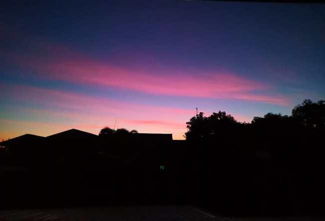 A dark Vientiane with a dazzling sky