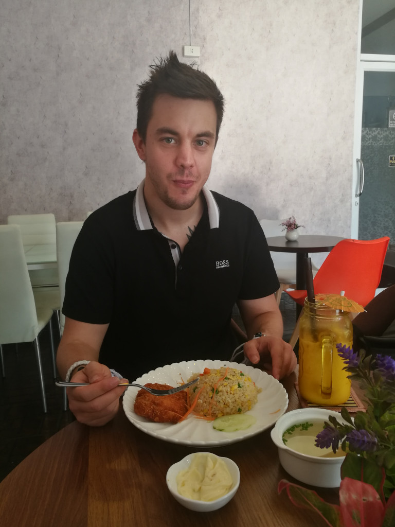 David Trendl (Team IX) enjoys a meal of crispy chicken