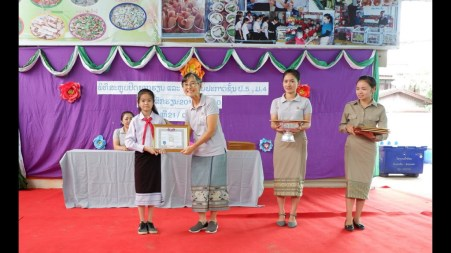 Headmistress Didi Gaorii with pupil and staff during an award ceremony