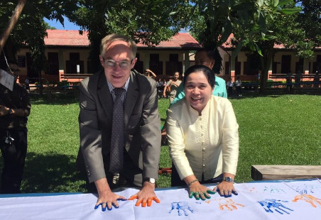 German Ambassador Jens Luetkenherm and Director of the Ministry of Education and Sports leave their handprints as a sign for the Global Handwashing Day (Global Handwashing 2017)