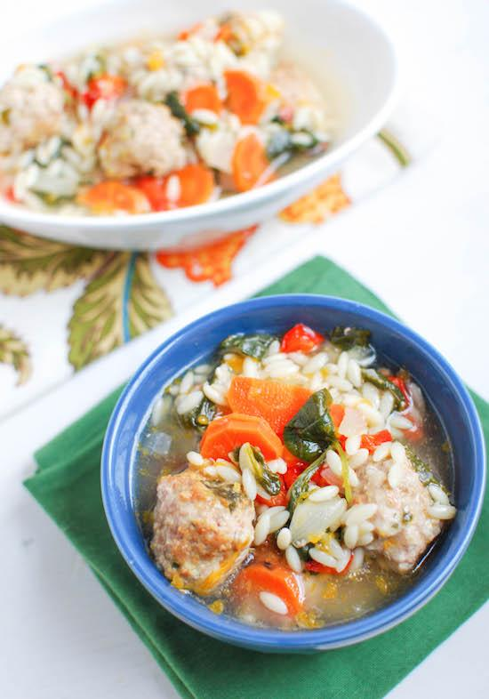 Packed with vegetables and mini meatballs, this Italian Wedding Soup is hearty, filling and sure to warm you up on even the coldest day!