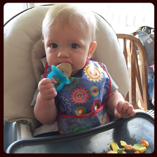 baby eating popsicle